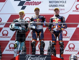 KTM Moto3 rider Oliveira of Portugal stands on the podium after winning the Australian Grand Prix on Phillip Island