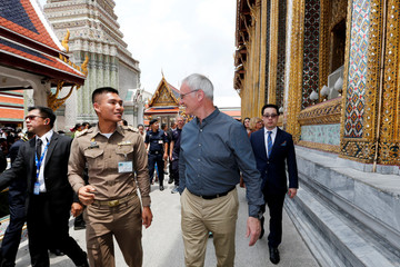 Leicester City soccer club's manager Claudio Ranieri and club's vice chairman Aiyawatt Srivaddhanaprabha walk during a visit at the Emerald Buddha temple in Bangkok