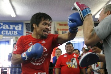 Boxer Manny Pacquiao works out ahead of his bout with Tim Bradley, in Hollywood