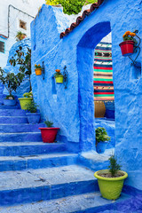 Famous blue medina with colourful details in Chefchaouen, Morocco.