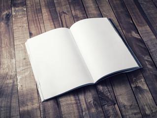 Blank open book, brochure or magazine on vintage wooden table background. Mock-up for graphic designers portfolios. Responsive design mockup.