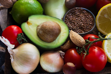 Organic vegetables,fruit, herbs,nuts,seeds in wooden box for healthy lifestyle, raw vegan diet, selective focus