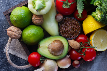 Organic vegetables,fruit, herbs,nuts,seeds in wooden box for healthy lifestyle, raw vegan diet, selective focus, top view