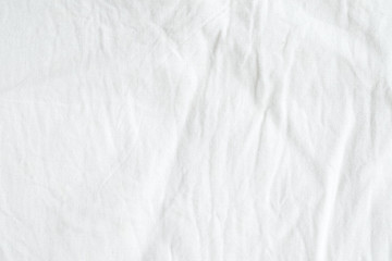 Wrinkled white cotton fabric texture background, wallpaper