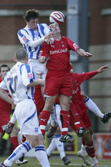 Scott McGleish (R) - Leyton Orient in action against Tommy Elphick - Brighton & Hove Albion