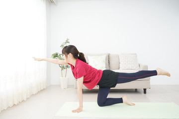 Young woman doing some stretches