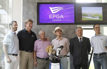 Golfer Ernie Els of South Africa poses for a photo with former Vietnamese Cabinet Minister Doan Manh Giao and other businessmen as he inaugurates the Els Performance Golf Academy in Hung Yen province, near Hanoi