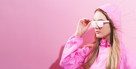 Wall Mural - Girl in trendy painted glasses in pink jacket