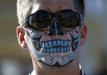 A Carolina Panthers wears makeup at Levi Stadium ahead of the NFL's Super Bowl 50 football game between the Carolina Panthers and the Denver Broncos in Santa Clara