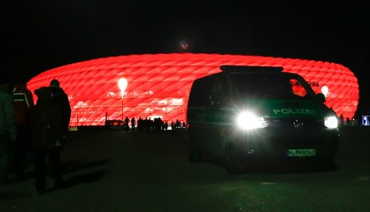 A police car drives in front of the Allianz Arena in Munich