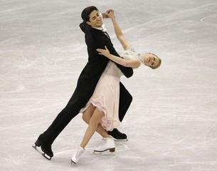 Weaver and Poje of Canada perform during the Ice Dance short dance program at Skate Canada International in Lethbridge
