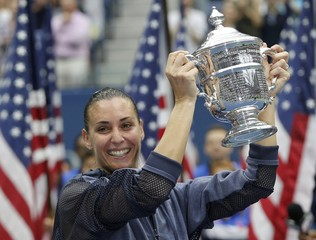Pennetta of Italy holds the U.S. Open Trophy after defeating compatriot Vinci in their women's singles final match at the U.S. Open Championships tennis tournament in New York
