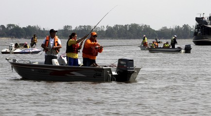 Fishermen take part in the Copa Hermandad international fishing competition in Asuncion, Paraguay