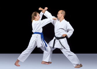 Karate technique is trained by adult athletes