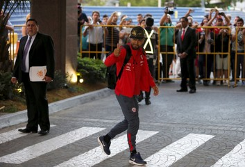 Chile's national soccer team player Arturo Vidal arrives at the Sheraton hotel in Montevideo