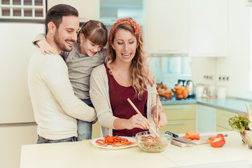Family preparing breakfast in kitchen