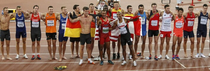 Athletes stand together after the 1500 metres decathlon event during the 15th IAAF World Championships at the National Stadium in Beijing
