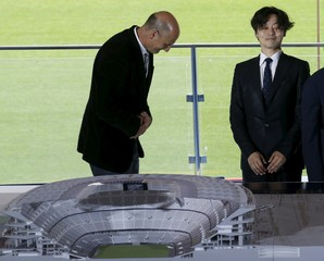 FC Barcelona member of the board Moix salutes architect Katsuka next to a model of the project to reform the Camp Nou stadium in Barcelona