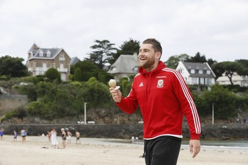 Wales' national soccer player Voke eats an icecream as he walks on the beach in Dinard