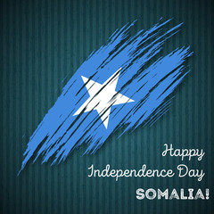 Somalia Independence Day Patriotic Design. Expressive Brush Stroke in National Flag Colors on dark striped background. Happy Independence Day Somalia Vector Greeting Card.