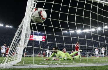 Gibraltar's goalkeeper Perez reacts after Georgia's Okriashvili scored penalty during their Euro 2016 qualifying soccer match in Tbilisi