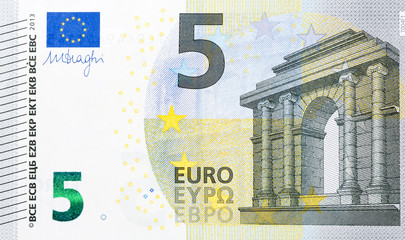 Macro detailed text on a 5 euro banknotes.
