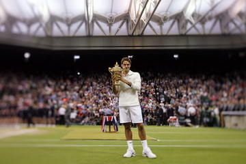 Men's Singles - Switzerland's Roger Federer celebrates victory in the final with the trophy