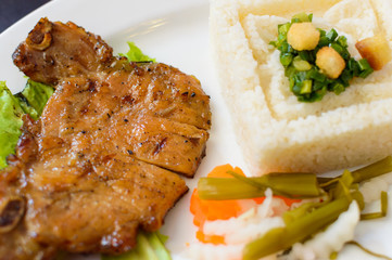 Grilled chop with rice and steam vegetables