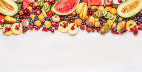 Printed roller blinds Fruits Variety of colorful organic fruits and berries on white table background, top view, border. Healthy food and vegetarian eating concept