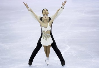 Yu Xiaoyu and Jin Yang of China  perform during the pairs short program at the ISU Grand Prix of Figure Skating final in Barcelona