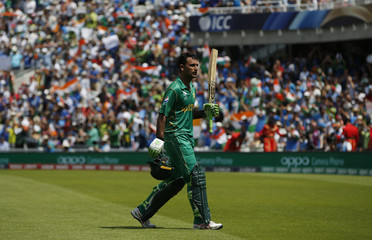 Pakistan's Fakhar Zaman acknowledges the crowd as he walks off after losing his wicket