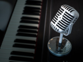 Single microphone on classical light background to performance the great show of world music.
