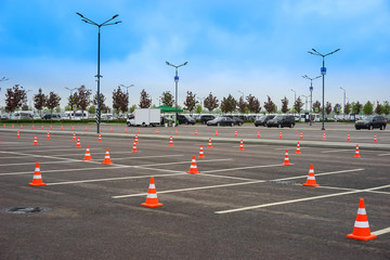 Parking space. Open parking for cars. Signal road cones.