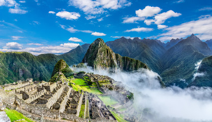 Foto auf Acrylglas Historisches Gebaude Overview of Machu Picchu, agriculture terraces and Wayna Picchu peak in the background
