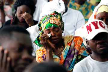 A family member cries during the national funeral ceremony of Ivorian soccer player Cheick Tiote, a former Newcastle midfielder who died during training at his Chinese club Beijing Enterprise, in  Abidjan