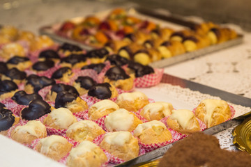 Tasty traditional sweets and pastries in italian shop