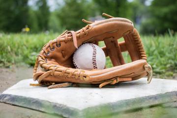 Glove and Baseball on Home Plate