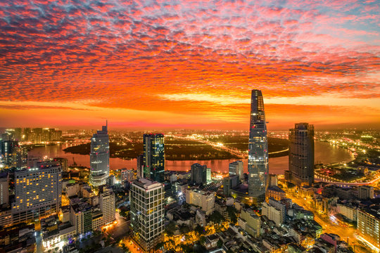 Aerial view of beautiful sunrise over high building and business centre of Ho Chi Minh City - The biggest city in Vietnam