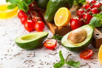 Avocado, cherry tomatoes, citrus and fresh herbs