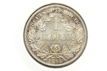 German silver coin 1 one mark 1914 obverse, denomination within circular wreath of oak branches, date below, imperial eagle with collar of the order and shield on chest, crown with ribbon above