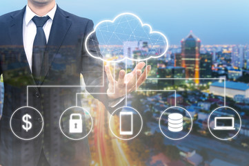 Double exposure of businessman connected Cloud technology with internet and wireless network with his smart phone and city of business background in business trading concept