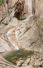 Mountainous, summer waterfall.