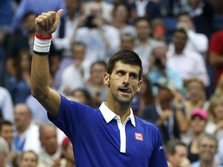 Djokovic of Serbia gives a thumbs-up after defeating Cilic of Croatia in their men's singles semi-final match at the U.S. Open Championships tennis tournament in New York