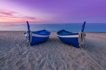 Blue wooden fishing boats on beach