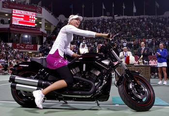 File photo of Russia's Maria Sharapova on a motorcycle at the Qatar Open tennis tournament in Doha