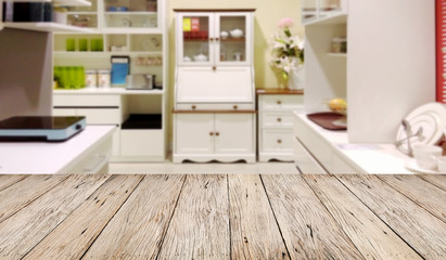 Empty wooden table floor with blur image of modern kitchen room interior , product montage display and design.