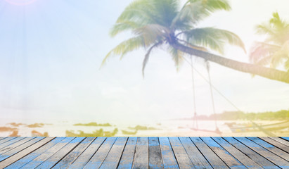 Wooden floor with tropical beach and palms trees, holiday and summer background.