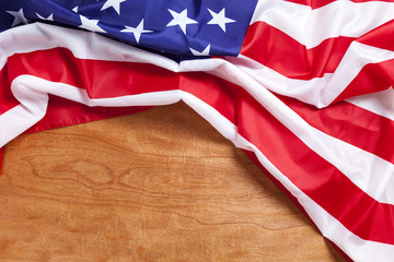 American flag on wood background for Memorial Day or 4th of July.