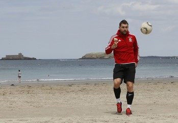 Wales' Sam Voke eats an icecream as he walks on the beach in Dinard