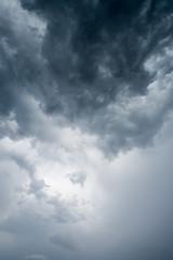 Keuken foto achterwand Hemel clouds with background,sunlight through very dark clouds background of dark storm clouds,black sky Background of dark clouds before a thunder.